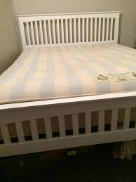 king size white wooden bed frame from wayfair