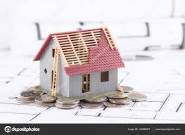 tiny house loans. Tiny House Stands On Coins. The Concept Of Banking, Loans, Expen \u2014 Stock Loans P