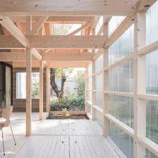 wooden home by yoshichika takagi features attic bedrooms and a translucent sunroom corrugated plastic
