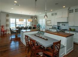 Traditional Kitchen With L Shaped Island Wood Counter With Attached Bench  And Dining Table