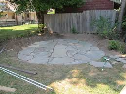 how to install a flagstone patio with irregular stones diy network blog made remade diy
