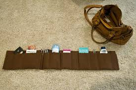 your organizer might be a bit too long mine was even though my purse is huge so you can double over the sides like the picture below