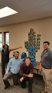arizona associates pose with what they created using cards containing our core values as part of