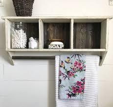 bathroom shelf with a hanging towel