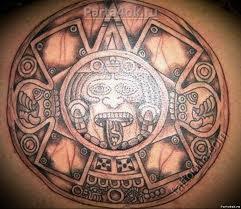 тату солнце на груди значение тату символы