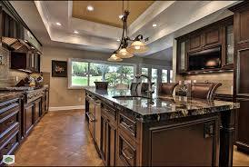 vinyl plank flooring kitchen traditional with dark cabinets granite granite