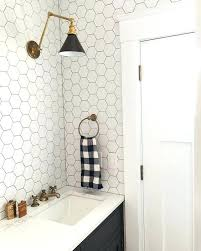 white hexagon tile bathroom white hexagonal tiles with black grout and black cabinets black and white