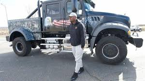 NFL star Khalil Mack, partnered with Mack Trucks, stops by company's ...