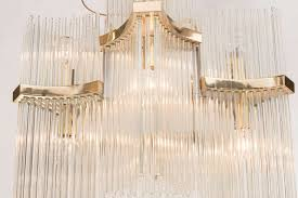 a mid century modern italian six arm glass rod and brass chandelier by gaetano