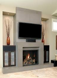 tv over fireplace with cabinets on either side