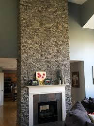 fireplace design with a touch of colored faux stone can help to brighten up an entire