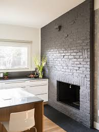 grey painted brick fireplace midcentury kitchen by design platform
