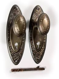 antique brass oval hardware sets in rus and erwin s alden design circa 1909 with elliptical brass doorknobatching backplates