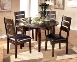 7 piece kitchen table sets bobs furniture kitchen table set 7 piece dining set round wood