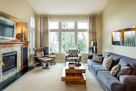 living room with recliners. contemporary living room idea in portland with beige walls recliners e