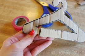Make a tiny cut at the bottom of the clothes hanger, this will make things  easier. (Don't worry we'll fix it later!)