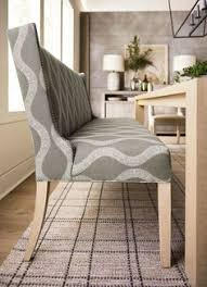upholstered banquettes that feature a tight back and seat along with subtle wings and wood legs