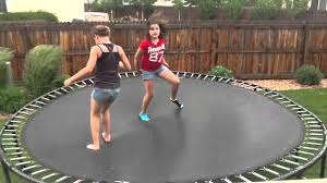 Girls jumping the trampolin