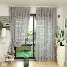 silver damask blackout panel curtain functional floor lamp with white shade green mercury glass vase wood floating shelf wall mounted picture frames wall