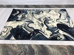 modern art area rug ivory navy blue water marble design with light blue and beige streaks ter rug 32 x60 rama