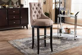 baxton studio harmony on tufted beige fabric upholstered bar stool with metal footrest modern and