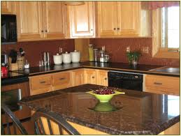 pictures of light oak cabinets with granite countertops