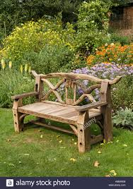 rustic wooden outdoor furniture. Ornate, Rustic, Wooden Garden Bench Seat Made From Recycled Parts, In Front Rustic Outdoor Furniture