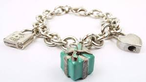 authentic tiffany co sterling silver charm bracelet with enamel gift box and 2 lock charm