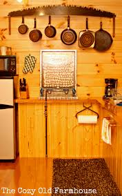 image vintage kitchen craft ideas. An Old Saw Blade Turned Into A Pot Rack, Ice Tongs/picks Paper Towel Holder, And Copper Piping Becomes Rack. Image Vintage Kitchen Craft Ideas