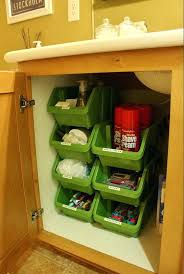 bathroom sink organizer stacking plastic bins under bathroom cabinet these stacking containers from the dollar tree