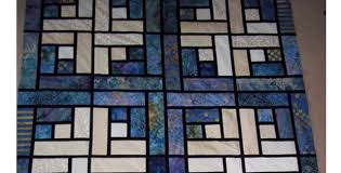 Stained Glass Quilt Pattern Delectable Batiks Make A Stunning Stained Glass Log Cabin Quilt With Clever