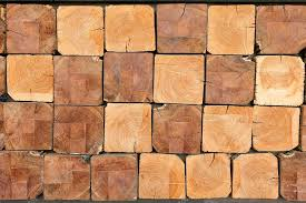 wood wall square background texture stacked wood stock photo