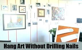 hang art without nails hang art without nails chic design how to wall on vinyl siding hang art