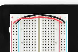 jumper wires connecting both sides of the power rails