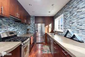 gorgeous kitchen with concrete countertops new paint mosaic tiled bath laminate flooring 3 bedrooms updated fireplace patio deck with large fenced