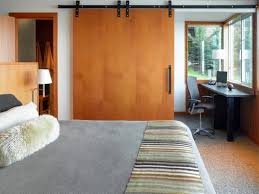 wooden sliding door for cozy interior design ideas for small bedrooms with striped blanket