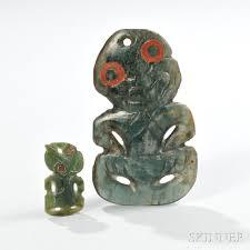 two maori jade tiki pendants