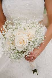 a simple bouquet of ivory roses and baby s breath photo via