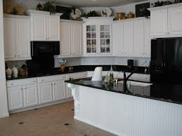 image of antique white kitchen cabinets with black appliances