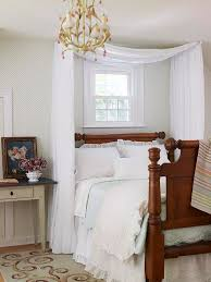 Small Bedroom   Frame A Headboard With A Canopy To Draw The Eye Up To The  Ceiling. A Simple Swag Of Fabric Loosely Draped Over Two Swing Arm Curtain  Rods ...