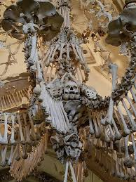 the grand chandelier in the bone church at kutna hora outside prague in the czech republic