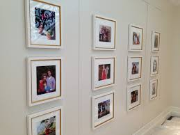 Arranging Family Pictures On Stairway Wall