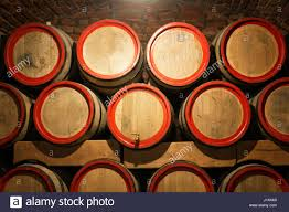 stacked oak barrels maturing red wine. Wine Barrels In The Antique Cellar. Cavernous Cellar With Stacked Oak For Maturing Red Wine. Selective Focus. E