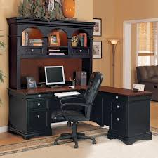 elegant black l shaped desk with hutch with drawers and black leather chair in wooden floor