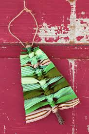 Use sticks and scraps of green ribbon to make this rustic Scrap Ribbon Tree  Ornament.