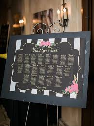 Seating Chart With Guest Names And Table Numbers On Black