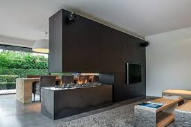 Media centers and fireplaces are commonly combined, and when they are also  part of a room divider the triple duty features may be functional but as  this ...