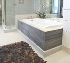 garden tub surround ideas. the barn siding is also used as tub skirt, complementing light tones of garden surround ideas
