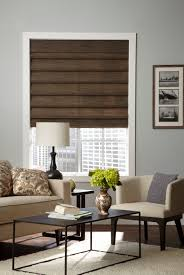living room decor roman blinds blackout roman shades with some picture frame and whie sofa for family