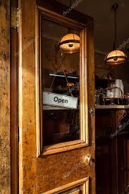funky wood cafe door open with open sign stock photo